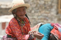 old-tibetan-woman-touching-malas-2010-calendar